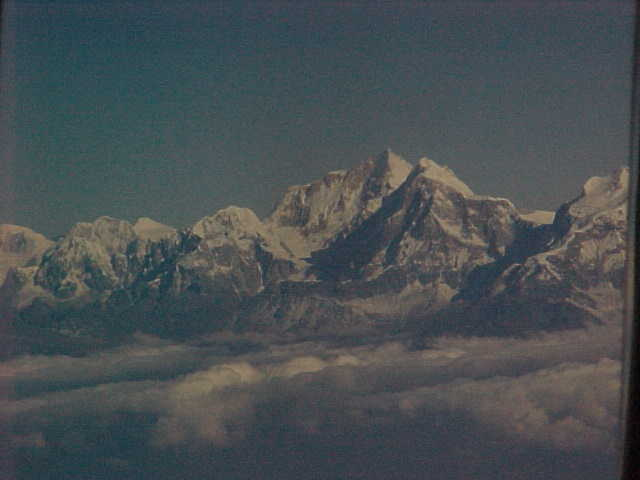 Last view of the Himalayas on our flight out (India, The Travel Addicts)