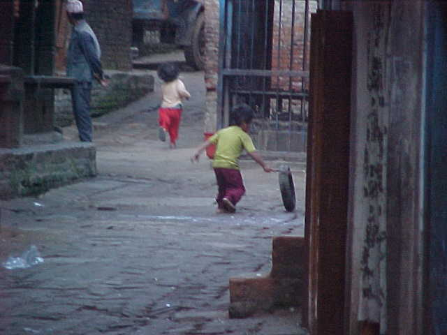 Playing (Nepal, The Travel Addicts)