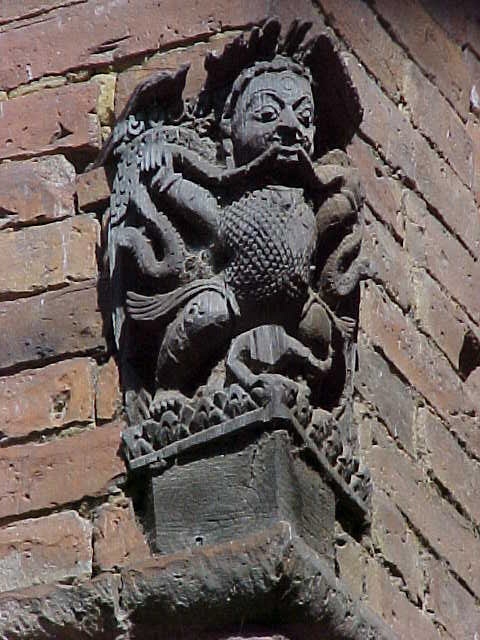 Cornice sculpture : Not a gargoyle.  Gargoyle's specifically function as drainspouts. (Nepal, The Travel Addicts)
