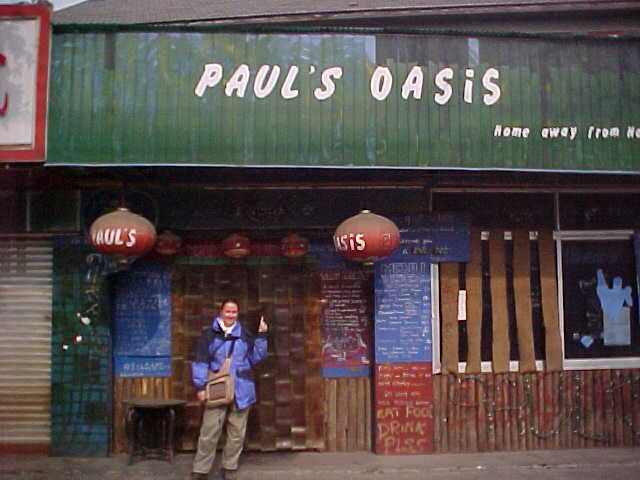 MVC-164S-Paul's Oasis Home away from home. SaraGrace Keenan. , Chengdu, Sichuan Sheng, China (成都, 四川省, 中国): Paul's was the only backpackers bar in Chengdu.  He was also likely the only non-westerner in the whole province to speak English comprehensibly. (The Travel Addicts, China)
