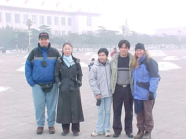 "MVC-174S-These locals wanted their pictures taken with us..  ""Dave Crane"", , , , and SaraGrace Keenan. , Taivaallisen rauhan aukio, Beijing, Beijing Shi, China (Tiananmen Square, 北京, 北京市, 中国): SGK and I made it a habit to reciprocate whenever a stranger wanted our photo, we would insist on getting theirs. (The Travel Addicts, China)"