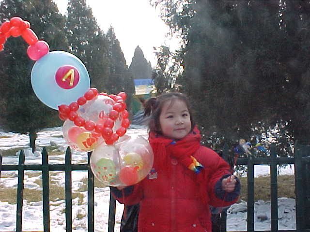MVC-186S-She had her own baloons. , Beijing, Beijing Shi, China (北京, 北京市, 中国): This is one place that I didn't need to hand out baloons; even if I could tie them as elaboratly as this! (The Travel Addicts, China)