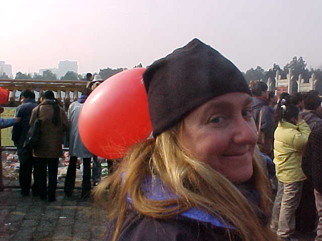 MVC-190S-Baloon recipient!. SaraGrace Keenan. , Beijing, Beijing Shi, China (北京, 北京市, 中国): We tied these baloons to ourselves so we could more easily find ourselves in the crowd (The Travel Addicts, China)