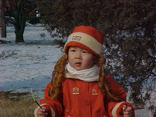MVC-199S-Goldie locks. , Beijing, Beijing Shi, China (北京, 北京市, 中国): Not sure if these red ringlets were attached to the hat or the girl. (The Travel Addicts, China)